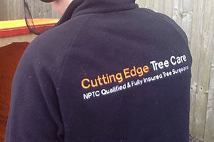 Cutting Edge Tree Care Professional wearing branded fleece